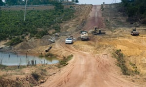 A car drives along BR-163, a key northern route for shipping Brazilian grains, in Para, northern Brazil.