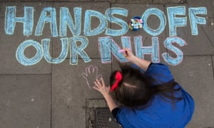 A junior doctor draws on the pavement during a strike at King's College hospital, London, April 2016