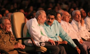 Fidel Castro talks to Venezuelan president Nicolas Maduro during his 90th birthday tribute in Havana while his brother and Cuban president Raul Castro sits to his right.