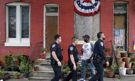 Police officers patrol in Baltimore on 23 June 2016.