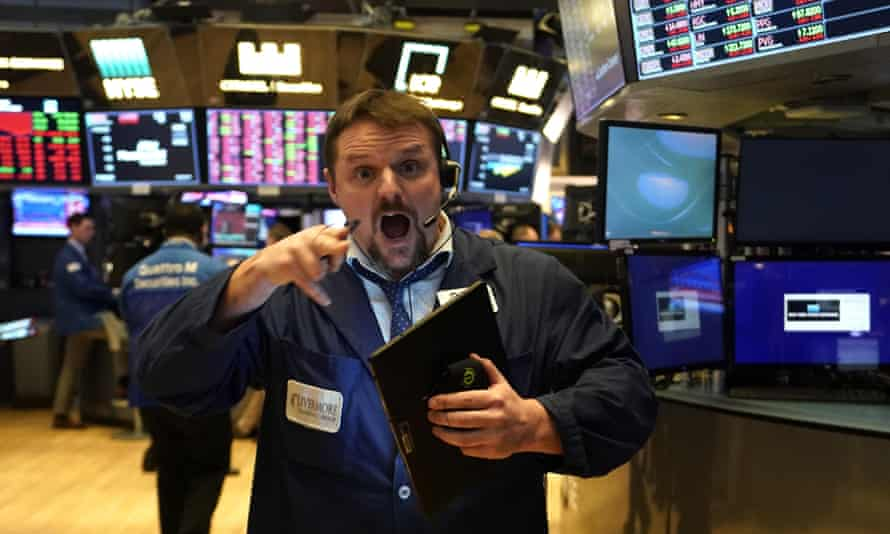 A trader on the floor of the New York Stock Exchange on 9 March, last year, when shares fell almost 8%.