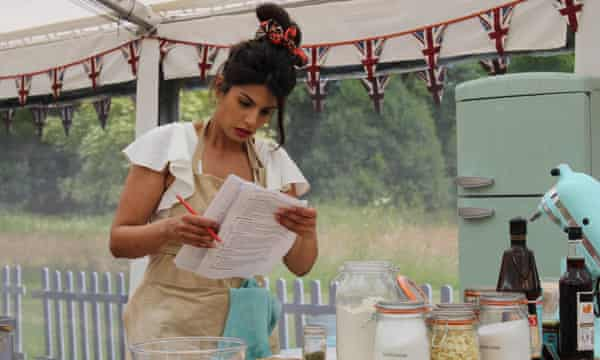 Ruby consults her checklist in The Great British Bake Off.