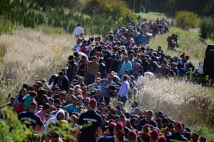 Zakany, Hungary: Refugees and migrants walk through the countryside after crossing the Hungarian-Croatian border on their trip north