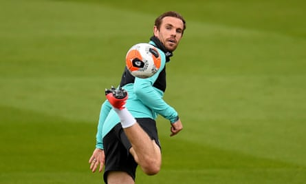 Liverpool's captain Jordan Henderson trains at Melwood