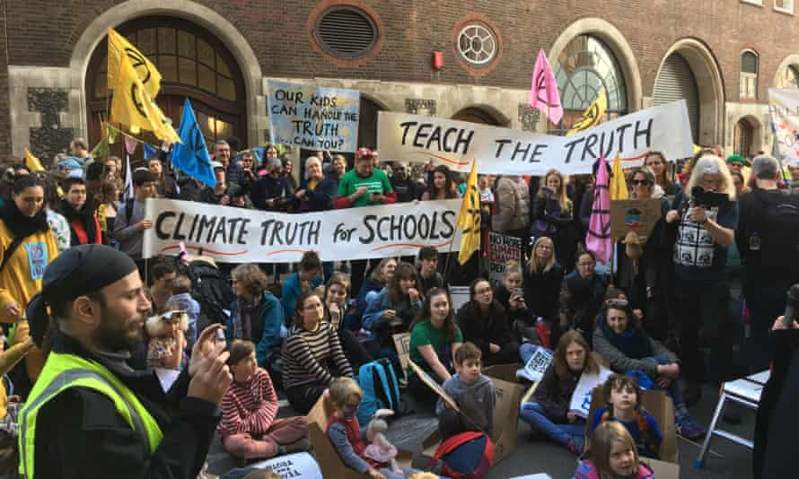 Teachers and pupils protesting outside the Department for Education in London last February against its lack of direction on the climate crisis.
