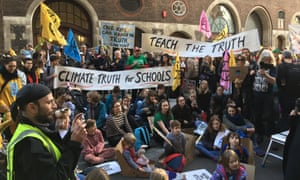 Teachers and students protest against the UK government's stance on climate change education