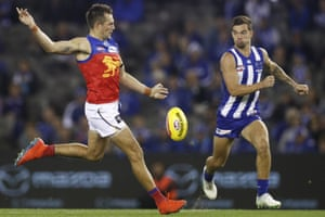 Luke Hodge of the Lions kicks the ball on his way to a Brisbane victory in round two of the AFL.