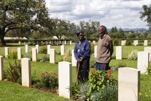 Eusebio Mbiuki and Gershon Fundi at a war cemetery