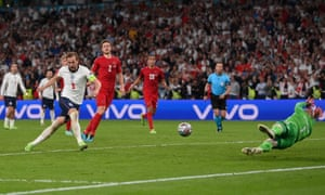 Harry Kane of England scores from the rebound of a missed penalty for their team's second goal.