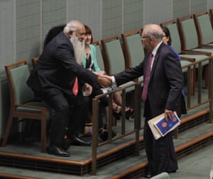 The prime minister Scott Morrison greets senator Patrick Dodson as he arrives in the house of representatives chamber to deliver the Closing the Gap report