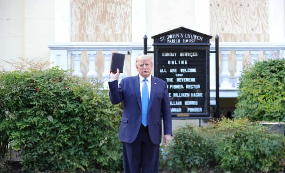U.S. President Donald Trump holds up a Bible as he stands in front of St. John's Episcopal Church across from the White House after walking there for a photo opportunity during ongoing protests over racial inequality.