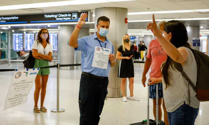 Travellers are informed about free Johnson & Johnson vaccines at the  Miami international airport, Florida.