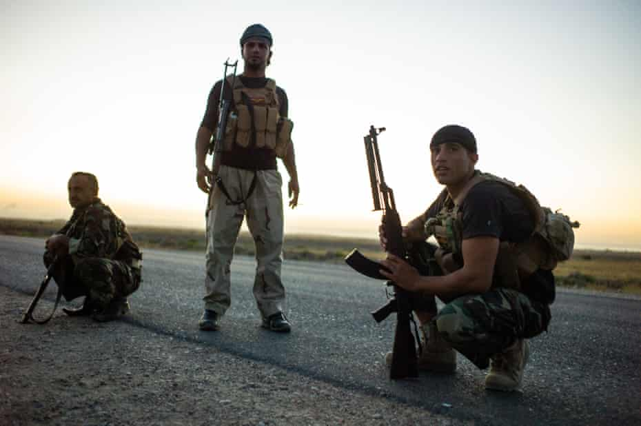 Members of the Asa'ib Ahl Aal-Haq, on the frontlines with Isis, in Diala province to the east of Baghdad, in July 2014. Assaib Ahl al-Haq is one of the 'loyalist factions' of the Hashed, with allegiances to the Iranian military and religious leadership.