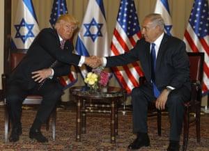 Trump and Israel's prime minister, Benjamin Netanyahu, shake hands at their meeting in Jerusalem