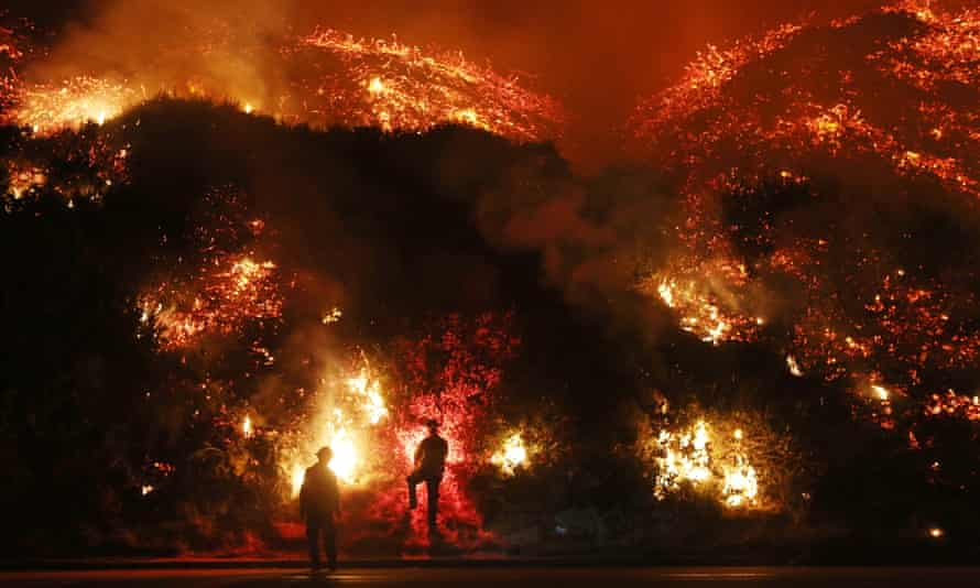 Welcome to Christmas in California.  Firefighters monitor a section of the Thomas Fire along the 101 freeway on December 7, 2017 north of Ventura, California. Strong Santa Ana winds are rapidly pushing multiple wildfires across the region, expanding across tens of thousands of acres and destroying hundreds of homes and structures.