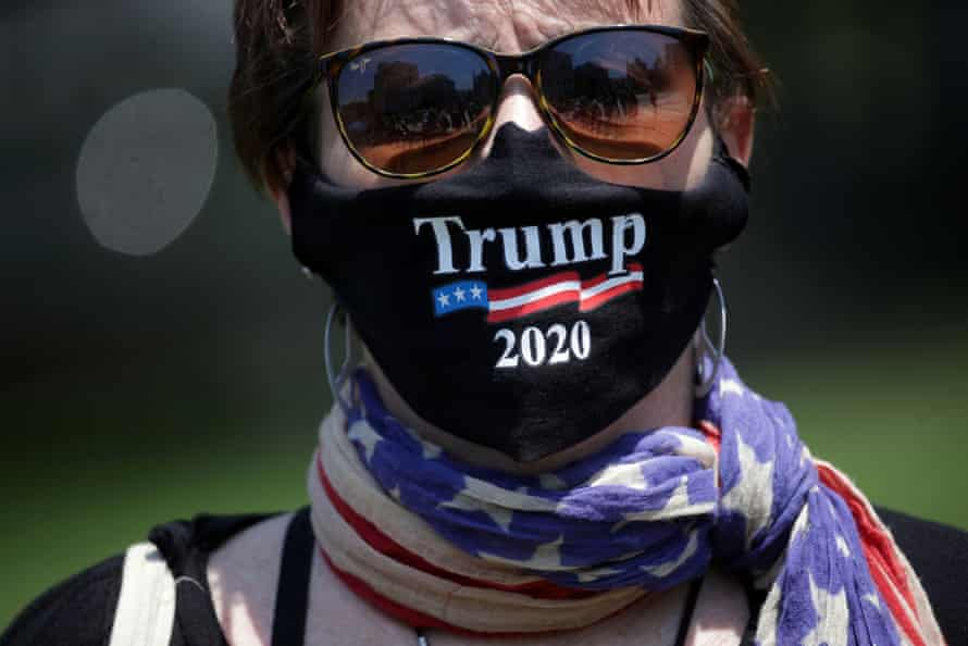 A protestor wears a Trump face mask while rallying against the coronavirus restrictions in Pennsylvania.