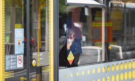 A passenger wearing a mask on a tram in Manchester.