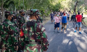 Soldiers check masks in Denpasar, on the island of Bali.