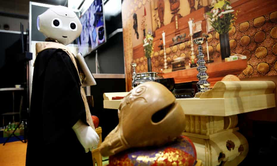 A 'robot priest' wearing a Buddhist robe stands in front of a funeral altar during its demonstration at Life Ending Industry Expo 2017 in Tokyo, Japan.
