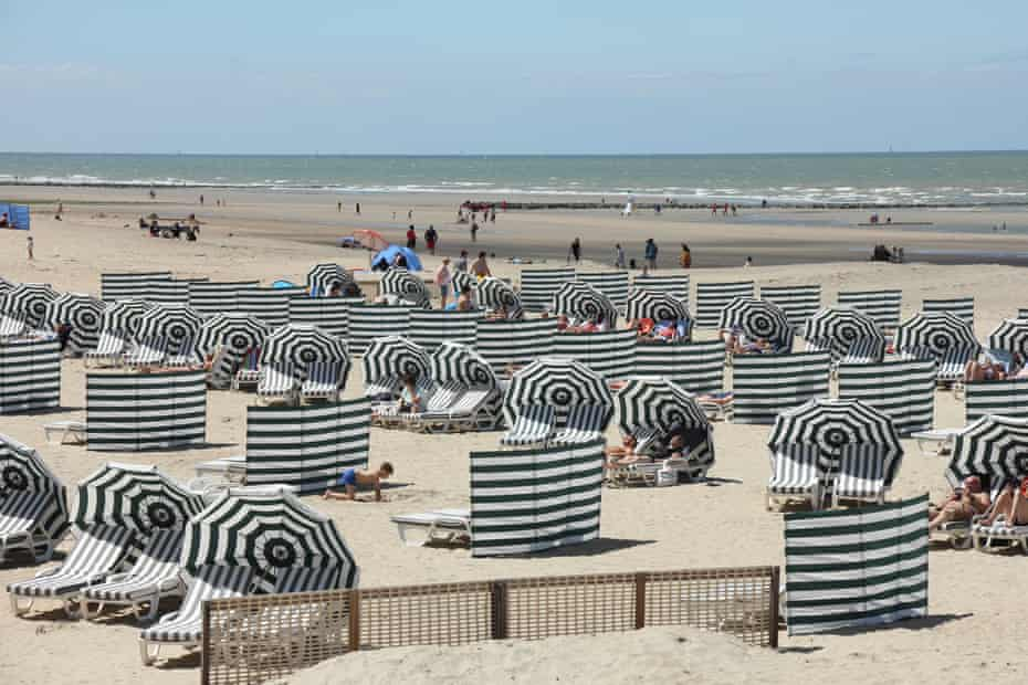 With striped retro windbreakers and and umbrellas the coast resembles a Victorian seaside postcard