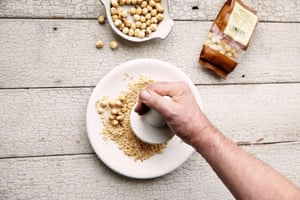'Grind the hazelnuts in a pestle and mortar or a food processor until fine, with a little bite remaining.'