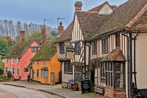 Houses painted traditional ochre and Suffolk pink in the village of Kersey, Suffolk UK.