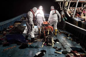 Members of Proactiva Open Arms NGO evacuate a man who died in a stretcher. Many of the vessels were filled with bodies of those who had died on the journey