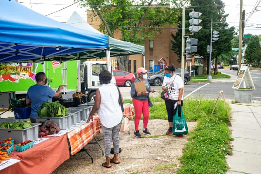 People shop at the Arcadia Mobile Market in the Fort Dupont neighborhood in Washington DC.