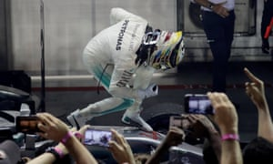 Lewis Hamilton celebrates winning the race.