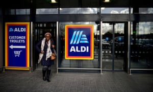 A shopper leaves an Aldi store in London
