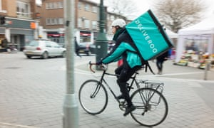 A bicycle courier delivering food in Exeter. Nearly half of the self-employed earn less than £7.20 an hour.