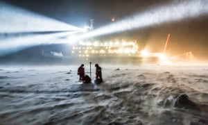 scientists from the research ship polarstern working among snowdrifts on the polar ice