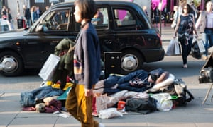 A rough sleeper beds down on Oxford Street, London.