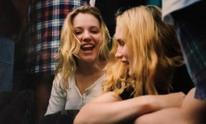 Two girls with long blonde hair laughing
