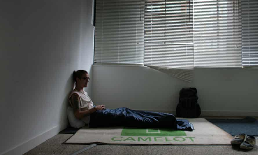A squatter inside Camelot Europe's former offices in Shoreditch, east London.