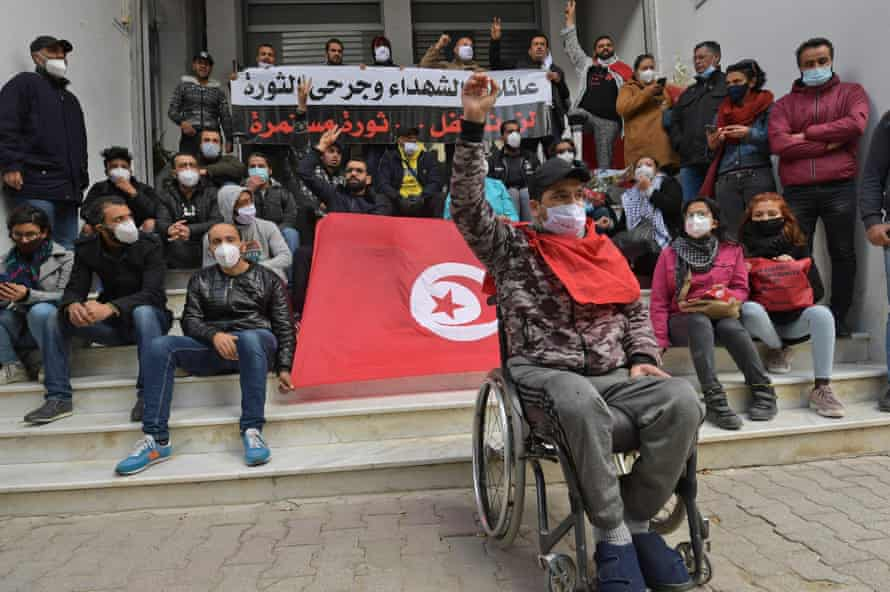 A protester who was injured during the revolution shouts anti-government slogans in Tunis 10 years after the revolution.