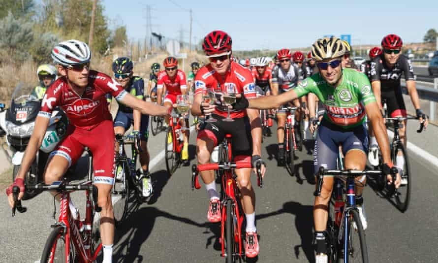 Chris Froome, centre, toasts with second placed Vicenzo Nibali (right) and third placed Ilnur Zakarin.