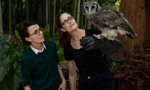 Barbara Natterson-Horowitz and Kathryn Bowers with an owl on a gauntlet.