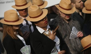 Activists in Berlin wear Panama hats in protest against tax avoidance, after the release of the Panama papers