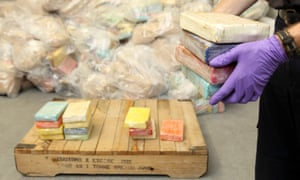 An official with seized cocaine packages.