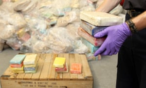 An HM Customs and Excise officer with drugs recovered from a cocaine seizure