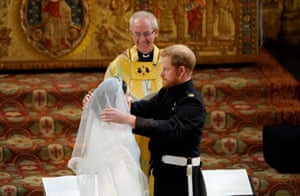 Prince Harry lifts the wedding veil