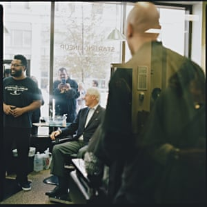 Former US President Bill Clinton meets the staff at The Starting Lineup Barber Shop in Youngstown, Ohio