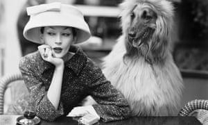 Model Dovima wearing Balenciaga at Les Deux Magots café in Paris, 1955