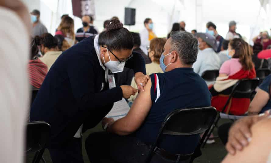 A vaccination centre in Chalco. Mexico has administered roughly 28m doses of the vaccine but many doctors and health workers have been denied.