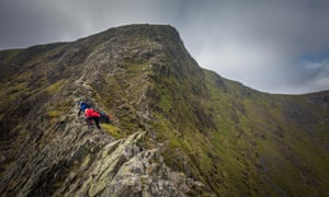 People scrambling up Sharp Edge