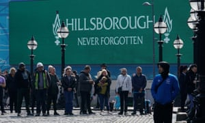 People take part in a one-minute silence outside Liverpool's Saint George's Hall.