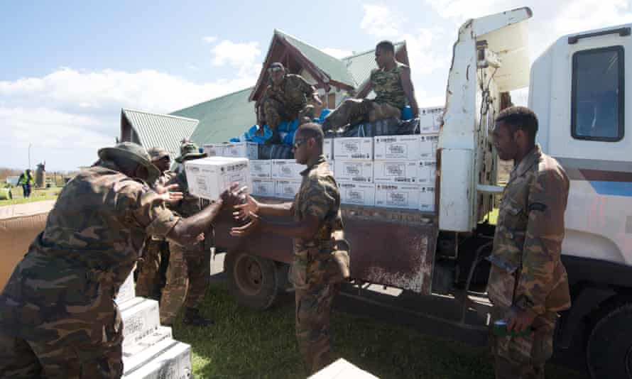 Supplies of bottled water are offloaded in Port Vila, the capital of Vanuatu, after Cyclone Pam devastated the country in 2015.