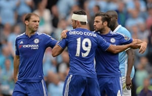 Ivanovic and Fabregas restrain Costa as they leave the pitch at half time.