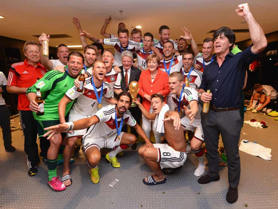 Joachim Löw and his players celebrate with the World Cup in 2014 alongside German Chancellor Angela Merkel and President Joachim Gauck.